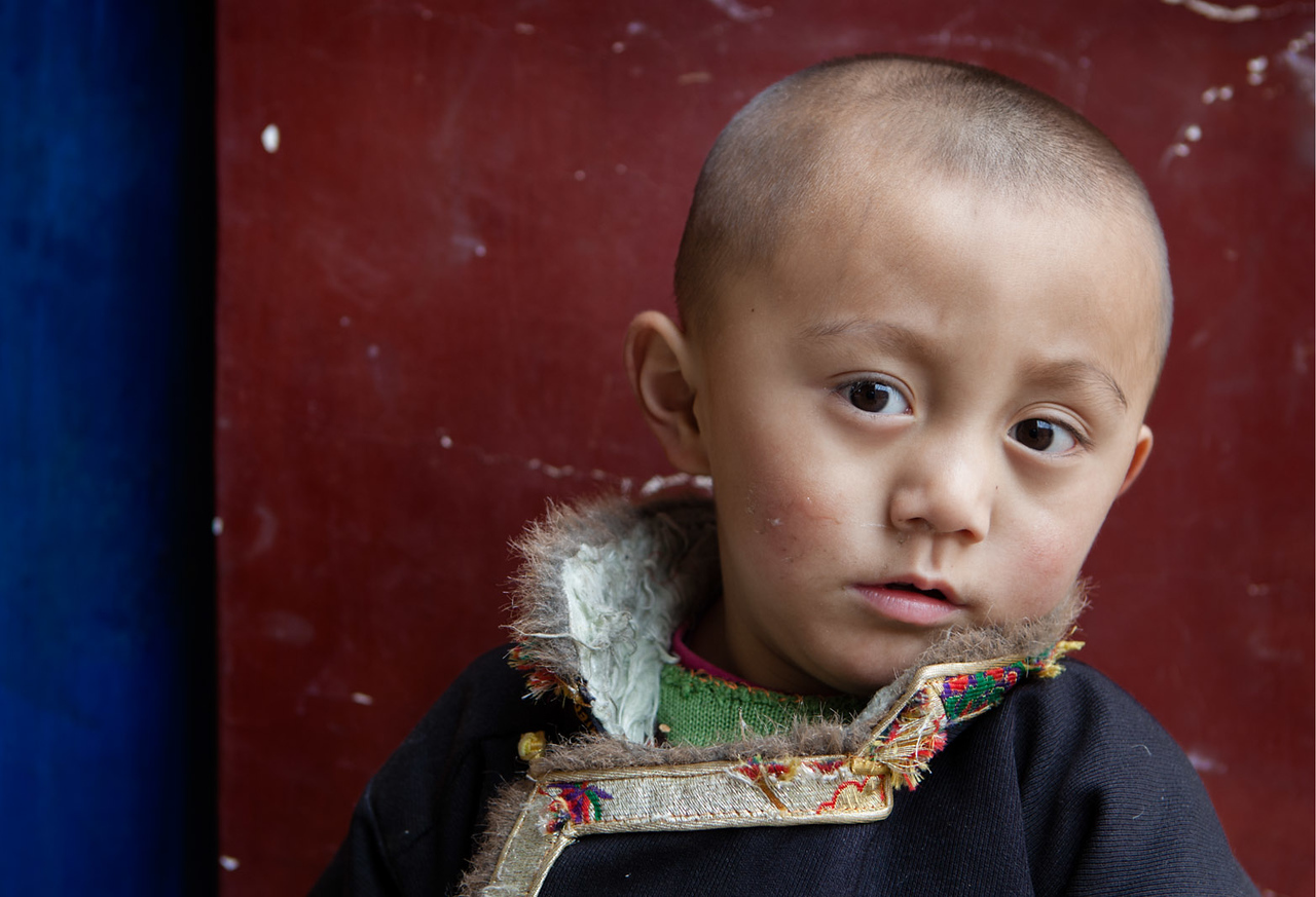 A young boy visiting the Rongpo Gonchen Monastery with his family, Repkong (Tongren), Amdo (Qinghai)