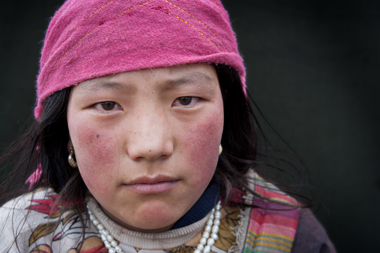 A young girl at a nomad camp. Zeku, Tsekok, Amdo (Qinghai)