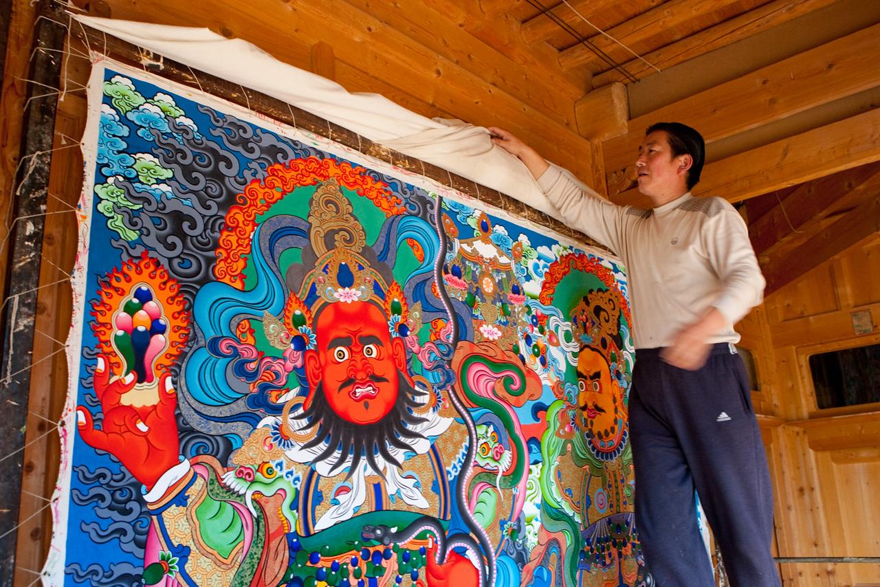 A Thangka painter and a work in progress, Repkong (Tongren), Amdo (Qinghai)