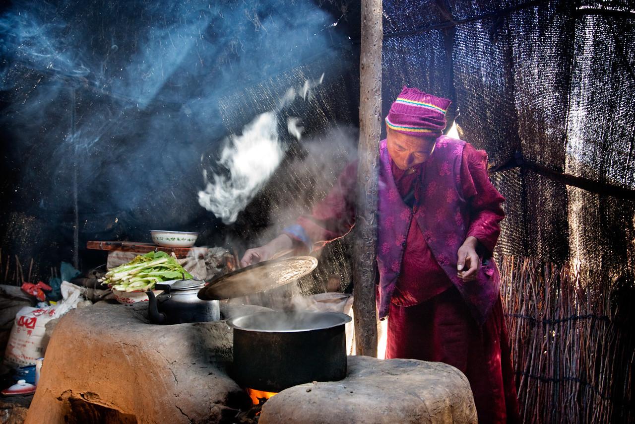Cooking food, nomed tent. Near Nangchen, Kham (Qinghai)
