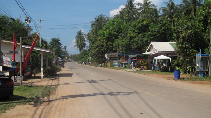 Driving along Klong Khong with restaurants along the road side