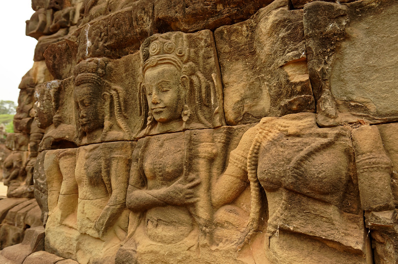 <i>Devata</i> along one wall of the Leper King Terrace. A later sculpture found on top of the terrace was presumed to depict a leper king, supporting a local legend that one of Angkor's early kings was a leper—hence the name.