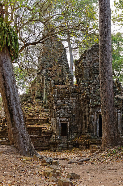 Preah Palilay's sandstone sanctuary, to the right, and its partially-collapsed tower, in back. The temple dates from the 13th or 14th century.