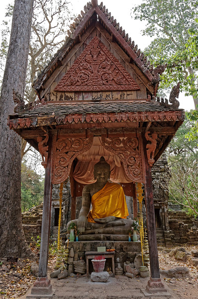 A more recent Buddha in the Victory-over-Mara mudra greets visitors as they approach the main sanctuary.