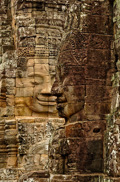 The temple is noted for its great number of monumental so-called face-towers, most with a face pointing in each of the cardinal directions. Those shown here are at the uppermost level, on the temple's central tower.