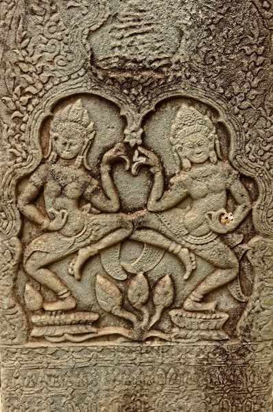 Bas-relief carving on one of the columns on the entrance terrace at the Bayon, depicting <i>apsaras,</i> heavenly dancers who entertained the gods