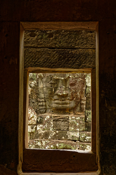 One of the face-towers seen through openings in a small chapel on the upper terrace