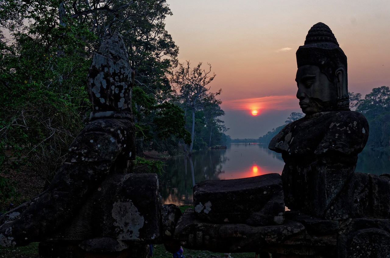 Sunset view from the bridge leading to the south gate of Angkor Thom