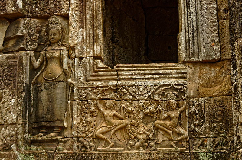 A <i>devata,</i> heavenly guardian spirit, and <i>apsaras</i> on the temple's upper level