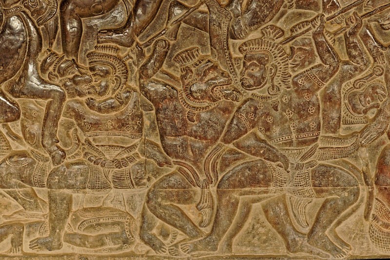 The extraordinary bas reliefs at Angkor Wat span a distance of well over 600 yards. This detail is from the Battle of Lanka, from the Hindu classic <i>Ramayana.</i> A monkey warrior, ally of Rama, is engaged in hand-to-hand combat with one of the evil Ravana's warriors.