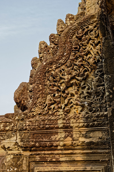A battle scene flanking the entrance of the western <i>gopura</i>