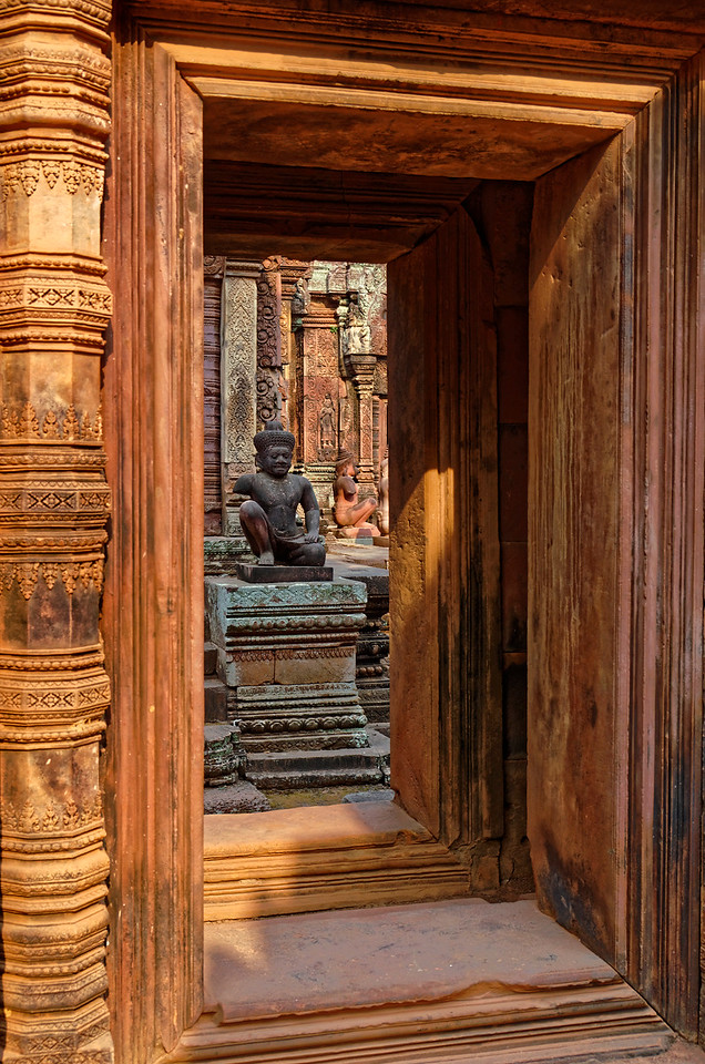 Temple guardians seen through a passageway leading to the inner sanctuary