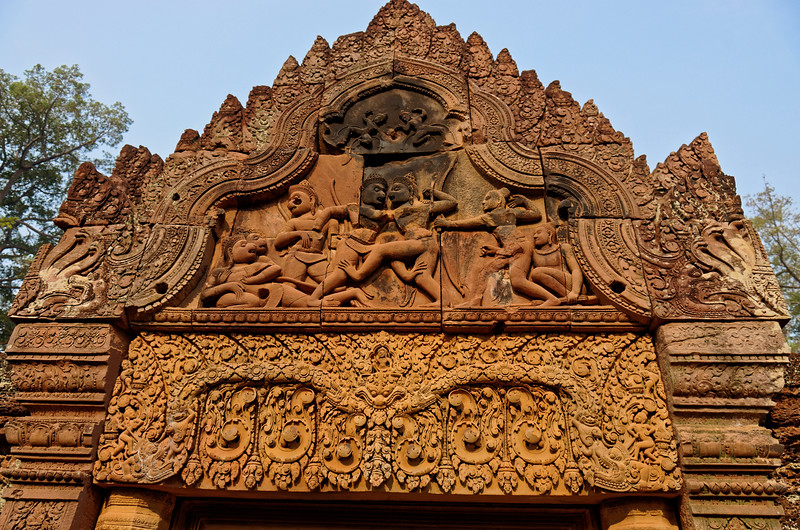 The scene on the pediment is from the <i>Ramayana.</i> It shows one of Rama's monkey allies, Sugriva, in hand-to-hand combat with his brother-turned-enemy, Vali.