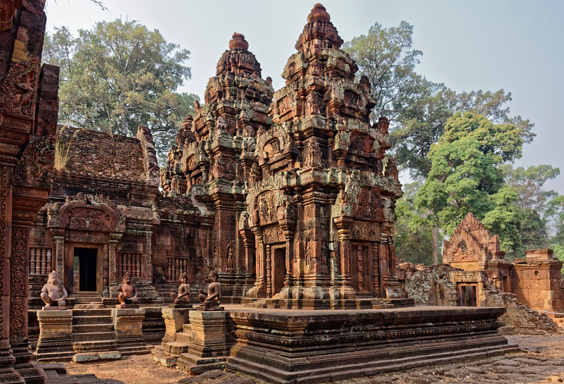 Three towers stand within the temple's inner sanctuary (the third barely visible here, to the left of the central tower). An entry vestibule, called a <i>mandapa</i>—partially seen behind the two monkey guardians at left—and a short connecting corridor to its right lead to the central tower.
