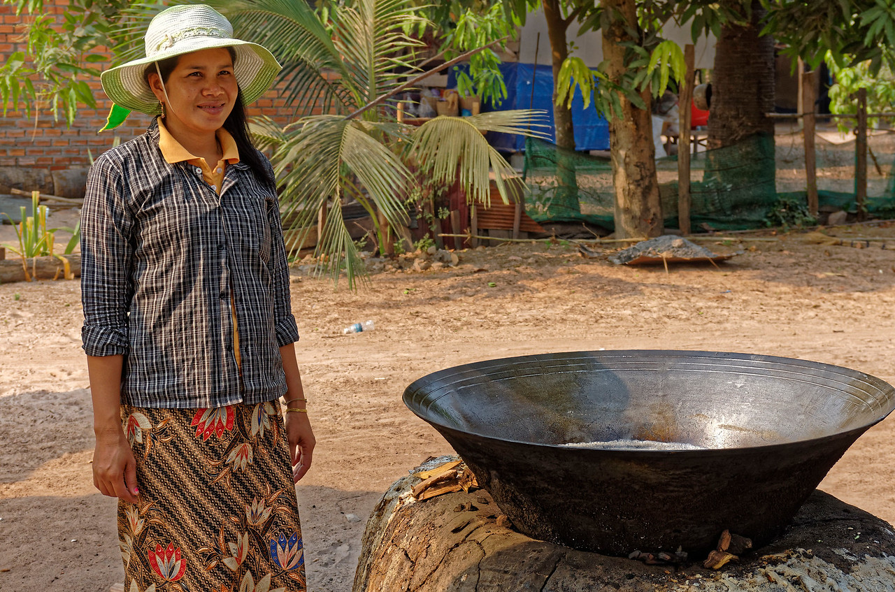 This woman makes sugar from sugar palm trees in the village of Pradak.