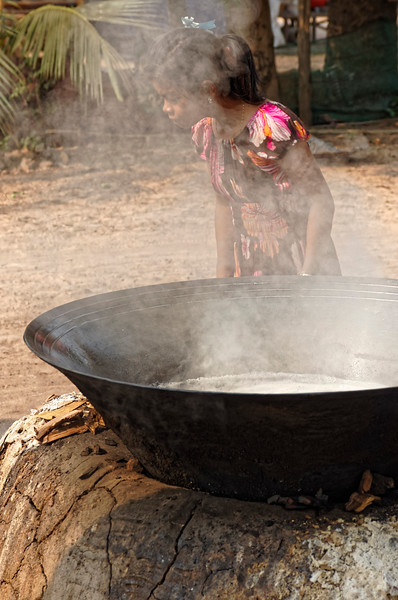 Once the juice is collected, it's boiled over an open flame until it begins to thicken.