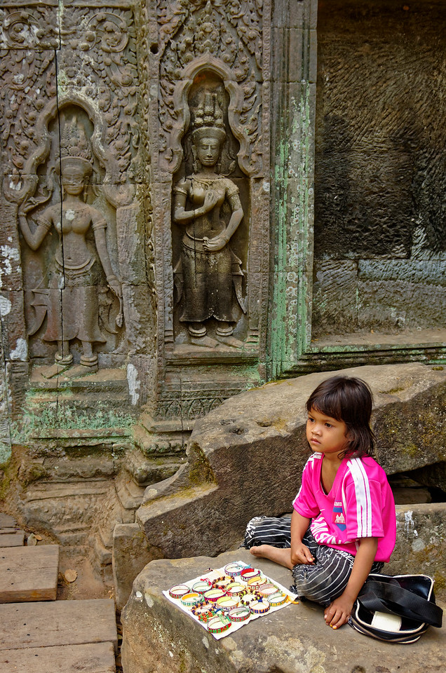 This little girl was selling bracelets at Ta Prohm (and looking rather bored, as well she may have been).