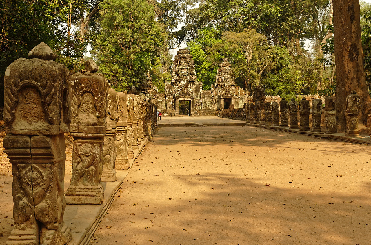 The approach to the western entrance <i>gopura,</i> lined with columns whose upper portions seem to be supported by stylized lion figures