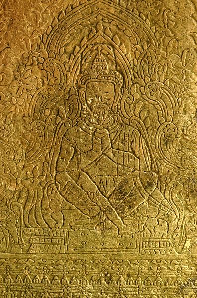 Meditating yogi carved on a support column