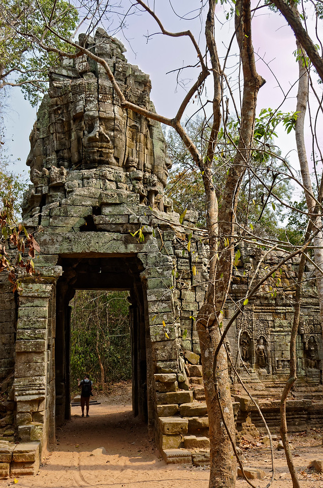 One of Ta Prohm's face-tower entry gates. The outermost wall of the temple enclosed an area large enough to accommodate more than 12,000 people who—according to one of the temple's inscriptions—lived there.