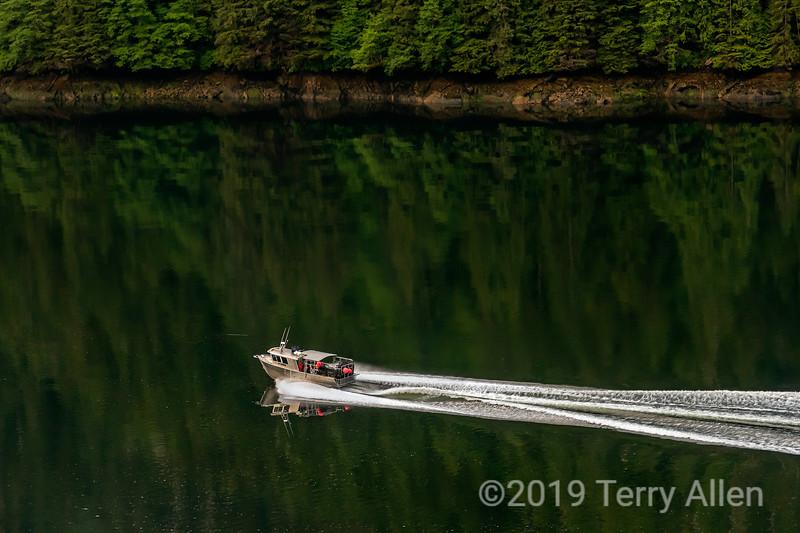Speeding crab boat with reflections, Khutzeymateen Inlet, British Columbia
