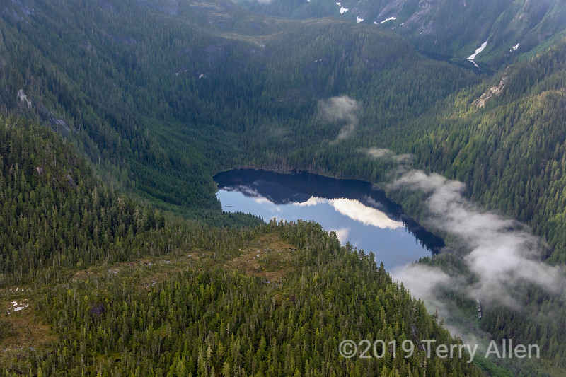 Mountain lake with reflections and morning mists, Great Bear Rainforest, coastal British Columbia