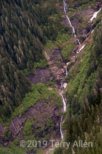 Long series of waterfalls in late spring, Kitimat Range of the Coast Mountains, British Columbia