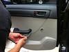 Removing door panel screw