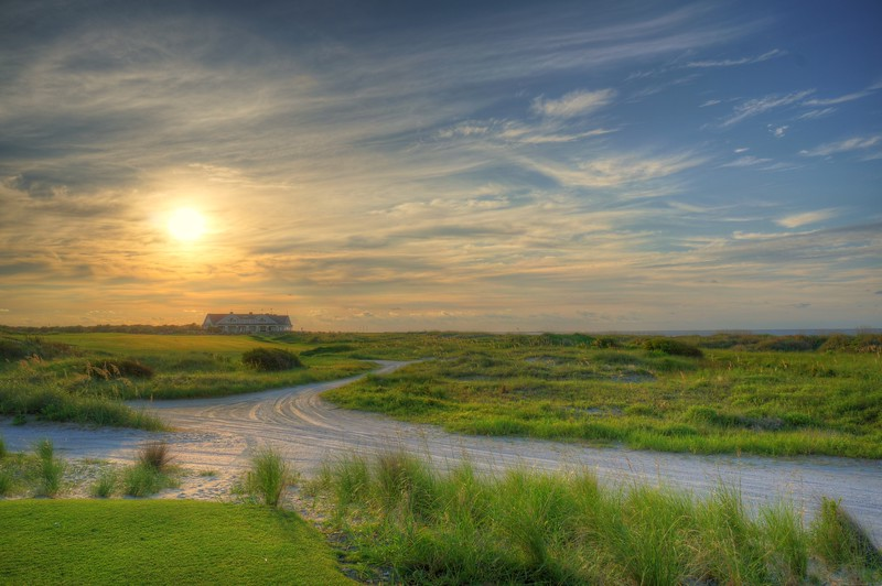 Sunrise over The Ocean Course Clubhouse with ocean