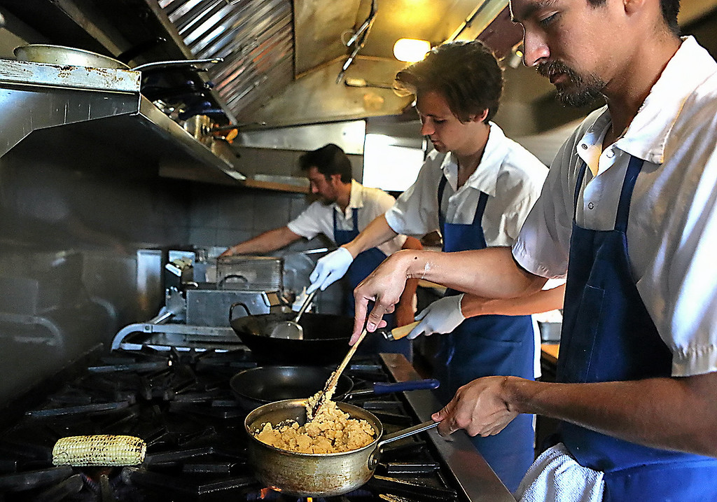 . The Kickin Chicken guys - Justin Williams, Matt Ruhland and Danny Mendoza stay busy in the kitchen. (Shmuel Thaler � Santa Cruz Sentinel)