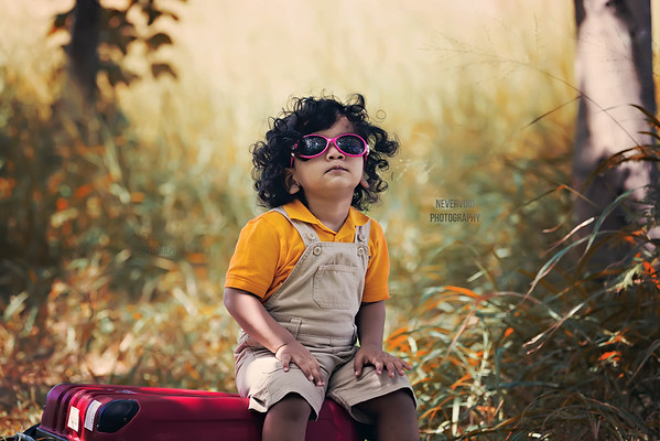 Am I looking cool! A cute baby with his shades on.