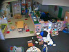 View of Pre-Toddler room from Webcam. Wes is in the blue and green coat. Getting ready to go outside to play.