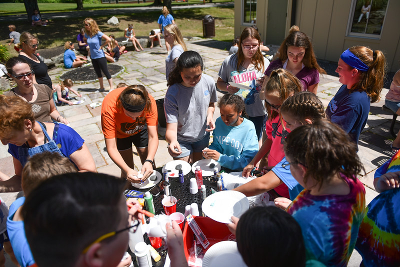 Kids gather supplies at the Lunenburg Public Library on Monday where kids and their families gather to draw inspirational messages on rocks which are to be displayed in nature throughout the community. SENTINEL & ENTERPRISE JEFF PORTER