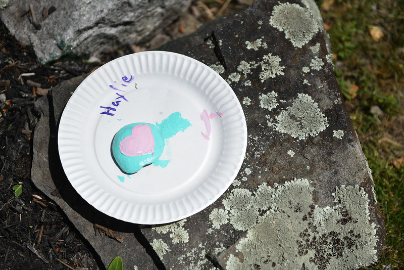Kids come up with creative way to paint rocks at the Lunenburg Public Library on Monday where kids and their families gather to draw inspirational messages on rocks which are to be displayed in nature throughout the community. SENTINEL & ENTERPRISE JEFF PORTER
