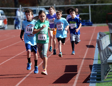 Tania Barricklo-Daily Freeman                      Olivia Serrano,9, and Chace Snyder,9, race to the finish line for the 4th grade boys and girls 1 Mile race at the kids Classic Saturday morning. Serrano came in first with Snyder coming in second close behind her.