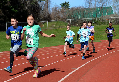 Tania Barricklo-Daily Freeman                      Fourth grade boys and girls take off for the 1 mile race at the Kids Classic Saturday.