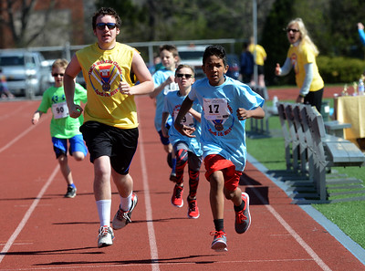 Tania Barricklo-Daily Freeman                      Elijah Bullock,9, races to the finish line and takes first place in  the boys 4th grade 400m race.