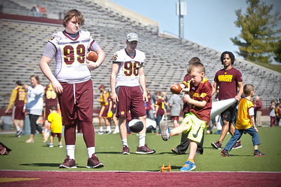 Smiles and laughter were aplenty on Saturday as CMU football hosted its 'Kids Clinic' prior to its spring game. (Sun photos by Paul Beroza)