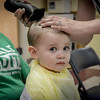 Christian Madigan of Billerica gets his very first hair cut for The Kid's Community Buzz-Off at the Community Congregational Church in Billerica. All the money and donated hair will be given to One Mission in support of the fight against cancer. SUN/Caley McGuane
