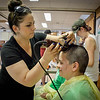 Vanessa Mello of Lowell shaves Heidi Madigan's head for The Kid's Community Buzz-Off at the Community Congregational Church in Billerica. All the money and donated hair will be given to One Mission in support of the fight against cancer. SUN/Caley McGuane