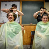 At left, Mike Madigan and his wife, Heidi of Billerica both get their heads shaved together for The Kid's Community Buzz-Off at the Community Congregational Church in Billerica. All the money and donated hair will be given to One Mission in support of the fight against cancer. SUN/Caley McGuane