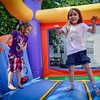At left, Payton Reyno of Andover and Lana Madigan have fun in the bouncey house at The Kid's Community Buzz-Off at the Community Congregational Church in Billerica. All the money and donated hair will be given to One Mission in support of the fight against cancer. SUN/Caley McGuane