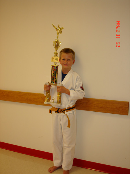 John holds up his first Trophy.
