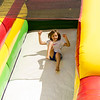 Laney Byington, 7, slides during Kid's Day in downtown Leominster on Saturday afternoon. SENTINEL & ENTERPRISE / Ashley Green
