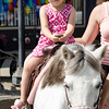 Tessa Ruiz, 4, rides a pony during Kid's Day in downtown Leominster on Saturday afternoon. SENTINEL & ENTERPRISE / Ashley Green