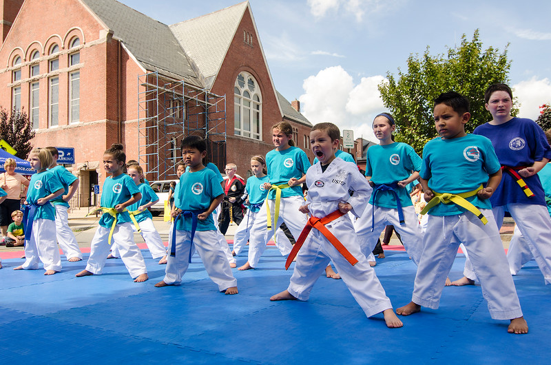 Kids from Leominster Taekwondo Center perform during Kid's Day in downtown Leominster on Saturday afternoon. SENTINEL & ENTERPRISE / Ashley Green