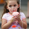 Aliana Young Diaz, 4, enjoys a snow cone during Kid's Day in downtown Leominster on Saturday afternoon. SENTINEL & ENTERPRISE / Ashley Green