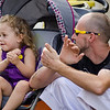 Alaynah Porier, 3, and dad Joseph enjoy some live music during Kid's Day in downtown Leominster on Saturday afternoon. SENTINEL & ENTERPRISE / Ashley Green