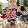 Amelia Walsh, 2, plays on the sand pile during Kid's Day in downtown Leominster on Saturday afternoon. SENTINEL & ENTERPRISE / Ashley Green