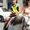Giovanny Rodriguez, 5, rides a pony during Kid's Day in downtown Leominster on Saturday afternoon. SENTINEL & ENTERPRISE / Ashley Green